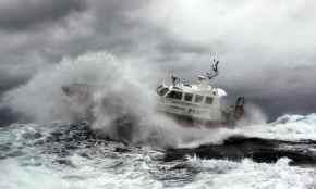 Waves crashing against boat 2