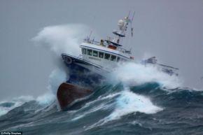 Waves crashing against boat one